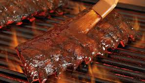 smoked ribs brushed with bbq sauce